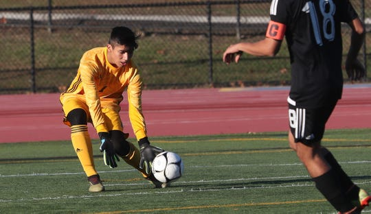 White Plains goal keeper Thomas Pisapia in action against Scarsdale during boys soccer playoff action at White Plains High School Oct. 24, 2019. White Plains won the game 4-1 in PKs.