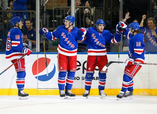 Oct 24, 2019; New York, NY, USA; New York Rangers defenseman Tony DeAngelo (77) reacts with his teammates after scoring a goal against the Buffalo Sabres during the second period at Madison Square Garden. Mandatory Credit: Andy Marlin-USA TODAY Sports