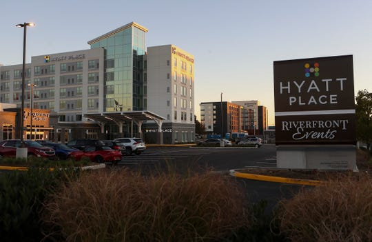 The recently completed Hyatt Place hotel (left) and neighboring Homewood Suites (rear) on the Wilmington Riverfront.