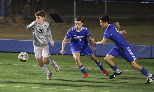 Appoquinimink's Thomas James Hastings (left) moves for the ball as Middletown's Andrew Peacock (3) and Raymond Kelly follow in the second half of the Jaguars' 4-0 win last Thursday at Cavaliers Stadium.