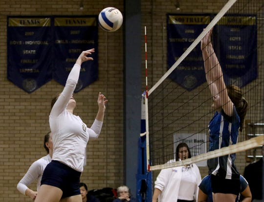 Notre Dame's Nell Rutherford hits the ball over to Alcuin Thursday, Oct. 24, 2019, at Notre Dame.