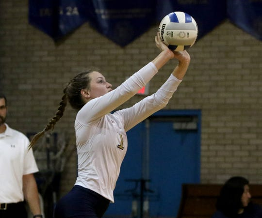 Notre Dame's Reagan Macha receives the serve from Alcuin Thursday, Oct. 24, 2019, at Notre Dame.