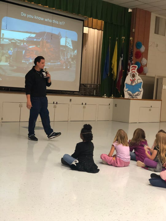 Joe Fiduccia talks with Fain Elementary students Friday about an Optimus Prime replica he created. The truck will be on display at the Wichita Falls Comic Expo this weekend at the MPEC.