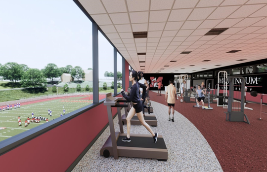The fitness and enhancement center will  have a glass front that overlooks the field.