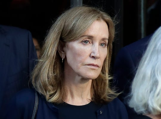 FILE - This Sept. 13, 2019 file photo shows actress Felicity Huffman leaving federal court after her sentencing in a nationwide college admissions bribery scandal in Boston.