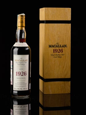 A rare bottle of Macallan Scotch whisky sold for almost $1.9 million at auction, setting a new auction record for any bottle of wine or spirit, Sotheby's said.