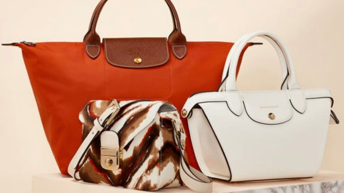 You can get Longchamp bags for amazing prices at Nordstrom Rack ...