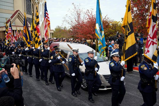 The honor guard proceeds past the hearse with the casket of Rep. Elijah Cummings following the funeral at the New Psalmist Baptist Church in Baltimore.