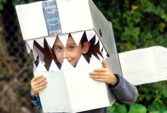 Make a shark costume out of an old Amazon box.
