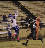 Bolton defensive back Da'Quan Smith  (13) picks off a pass against Leesville Friday night at Wampus Cat Stadium.