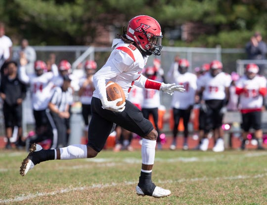 Neptune Willie Gross dives through the line and heads off on a long run for Neptune first touchdown.Neptune High School Football vs Colts Neck in Colts Neck NJ on October 26.2019.
