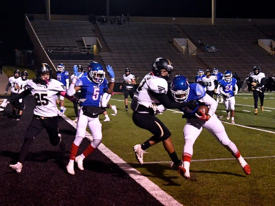 Cooper High running back Noah Garcia pushes his way into the end zone for a touchdown against Lubbock High during Friday's game at Shotwell Stadium Oct. 25, 2019. Final score was 49-14, Cooper.