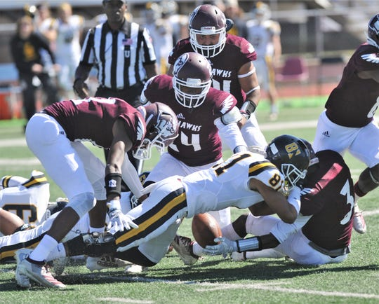 McMurry's Ke'Shaun Jnofinn(3) gets his hands on a Southwestern fumble. McMurry's Xavier Gayle (24) ended up recovering the ball, setting the War Hawks' second TD of the game.