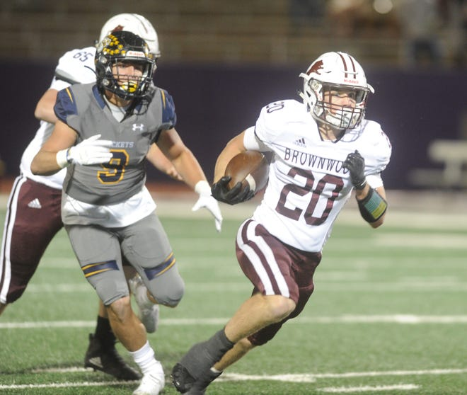 Brownwood running back Reece Rodgers (20) carries the ball in the first half against Stephenville on Friday, Oct. 26, 2019, at Tarleton Memorial Stadium in Stephenville.