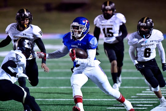 Cooper High running back Noah Garcia carries the ball downfield for a touchdown against Lubbock High during Friday's game at Shotwell Stadium Oct. 25, 2019. Final score was 49-14, Cooper.