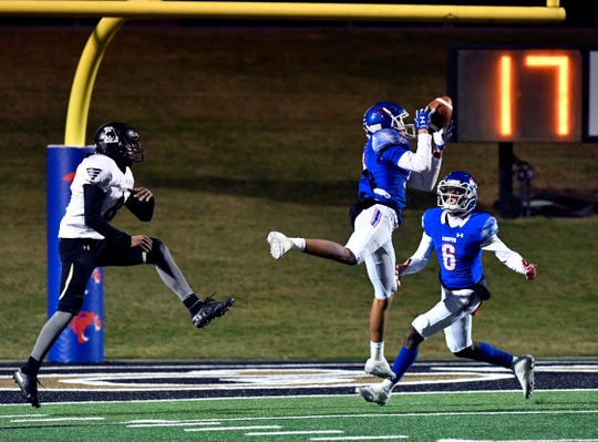 Cooper High defensive back Dylon Davis intercepts the ball meant for Lubbock High's Jose Barrera during Friday's game at Shotwell Stadium Oct. 25, 2019. Final score was 49-14, Cooper.
