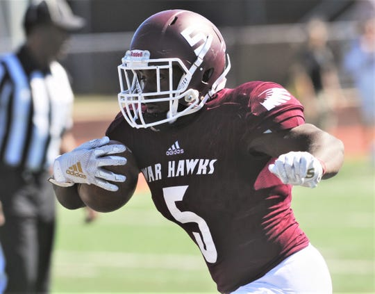 McMurry running back Kameron Session runs for a 9-yard touchdown to help the War Hawks to 15-7 lead with 3:48 left in the first quarter during their American Southwest Conference game against Southwestern. The War Hawks lost the game 29-25 on Saturday at Wilford Moore Stadium.