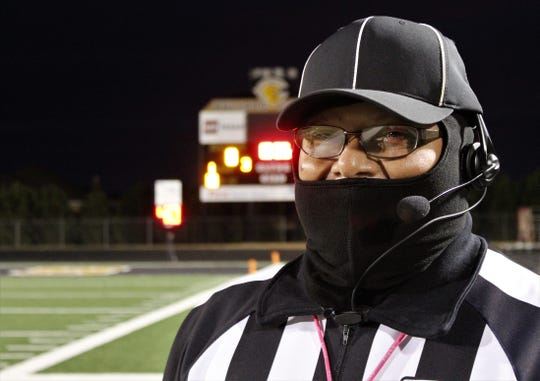 Freddy De Leon of Sweetwater, a football official for 41 years, dressed for warmth Oct. 25 at Bulldog Stadium, in Clyde, where the home team played Jim Ned. De Leon was the umpire on the officiating crew.