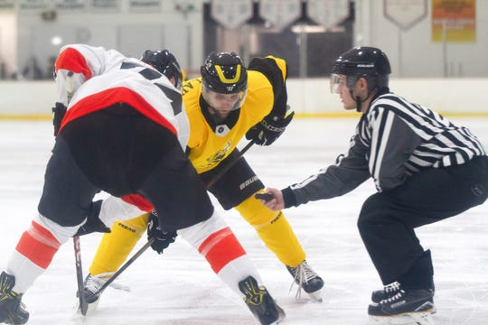 Battle Creek's John Champlain takes the face off for the Rumble Bees in the season opener at The Rink on Friday.