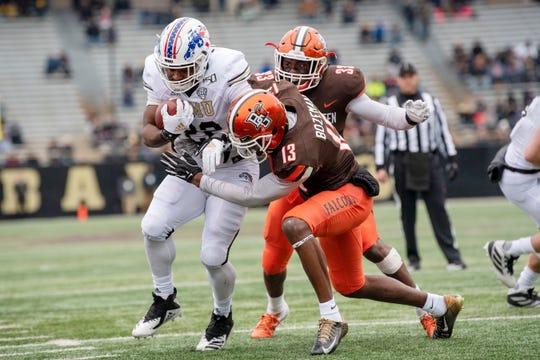 Western Michigan Broncos running back Davon Tucker (22) scores a touchdown as Bowling Green Falcons defensive back Jamari Bozeman (13) attempts to tackle him on Saturday, Oct. 26, 2019 at Waldo Stadium in Kalamazoo, Mich.