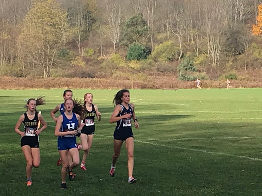 A pack of five girls lead in the early going of the Southern Tier Athletic Conference Championship meet Saturday at Ann G. McGuinness Elementary School. Corning's Faithe Ketchum, left, won in 18 minutes, 44.4. seconds.