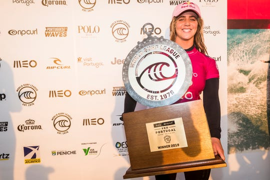 Caroline Marks of Melbourne Beach shows off  her trophy at the 2019 MEO Rip Curl Pro Portugal after winning the final at Supertubos on Saturday in Peniche, Portugal.