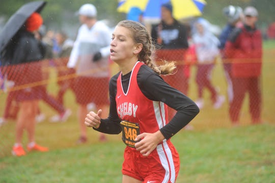 Shelby's Kayla Gonzales runs down the final stretch of the D-II regional meet.