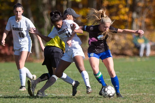 Colchester's Jessica Laquerre, right, tries to shield the ball from Essex's Souma Mitra during a Division I high school girls soccer quarterfinal on Saturday, Oct. 26, 2019.
