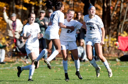 Essex players celebrate a goal By Gabrielle Knight, second from right, during a Division I high school girls soccer quarterfinal on Saturday, Oct. 26, 2019.