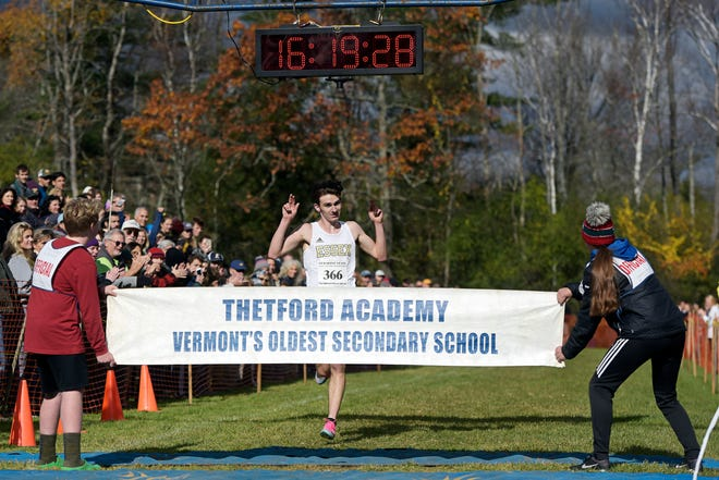 Henry Farrington of Essex wins the Division I title in a time of 16:19.4 at the Vermont State Cross Country Meet at Thetford Academy on Saturday, Oct. 26, 2019.