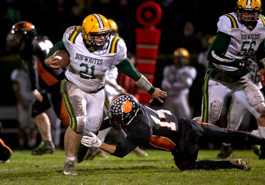 BFA-St. Albans running back Owen Bonnette, left, carries the ball during a Division I high school football quarterfinal game in Middlebury on Friday, Oct. 25, 2019.