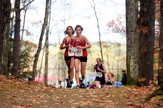 CVU's Jasmine Nails, left, and Alice Larson compete in the Division I title in a time of 19:33.9 at the Vermont State Cross Country Meet at Thetford Academy on Saturday, Oct. 26, 2019. The Redhawks won the D-I team title over runner up Essex, 21-60.