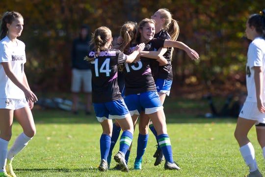 Colchester players celebrate a goal by Madison Chagnon, center, during a Division I high school girls soccer quarterfinal on Saturday, Oct. 26, 2019.