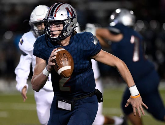 Veterans Memorial's quarterback Carter Senterfitt runs with the ball at the game against Miller, Friday, Oct. 26, 2019, at Buc Stadium. Miller won, 50-43 in double overtime.
