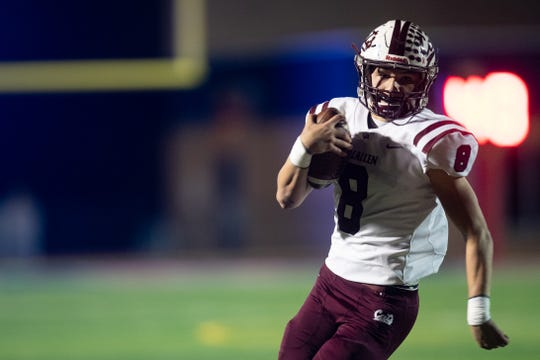 Calallen's quarterback Jarrett Garza runs the ball during the second quarter of their game against Gregory-Portland's at Ray Akins Wildcat Stadium in Portland on Friday, Oct. 25, 2019.