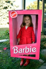 The Barbie box costume is a fun, simple, and affordable look for Halloween.