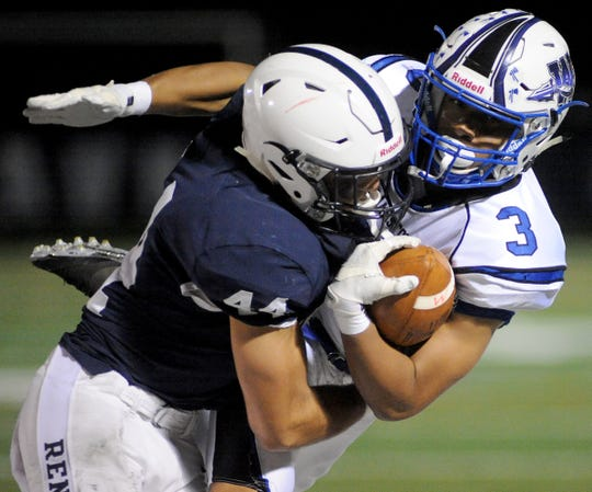 Shawnee's Dalton Short tackles Williamstown's Quinn Hart during Friday night's football game at Shawnee High School, Oct. 25, 2019.