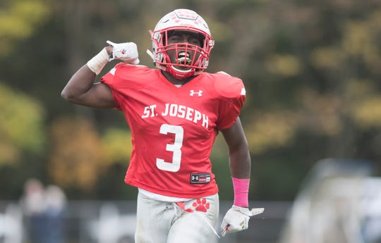St. Joseph's Jada Byers celebrates a touchdown earlier this season. Byers scored a state-record 10 during a 76-22 win over Morris Catholic in the Non-Public 2 semifinals on Saturday. He also set the state's career TD mark with 102.