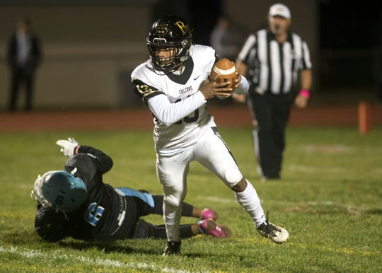 Burlington Township's Donte' Thompson runs the ball during the 2nd quarter of the football game between Highland and Burlington Township played at Highland Regional High School in Blackwood on Friday, October 25, 2019.