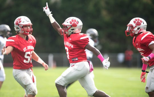 St. Joseph's Jada Byers, center, celebrates after catching an interception during the 1st quarter of St. Joseph's 41-16 win over Timber Creek in Hammonton on Saturday, October 26, 2019.