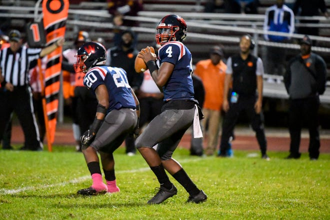 Willingboro's Ah-Shaun Davis (4) looks for a receiver during a game against Woodrow Wilson Friday, Oct. 25, 2019 in Willingboro, N.J. Willingboro won 22-18.