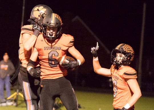 Waverly wide receiver Will Futhey celebrates with teammates during a 38-22 win over Minford.