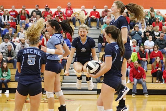 Adena's Hannah Burns (#2) celebrates with teammates during the Warriors' 3-1 district championship win over the Zane Trace Pioneers on Saturday Oct. 26, 2019 at Waverly High School in Waverly, Ohio.