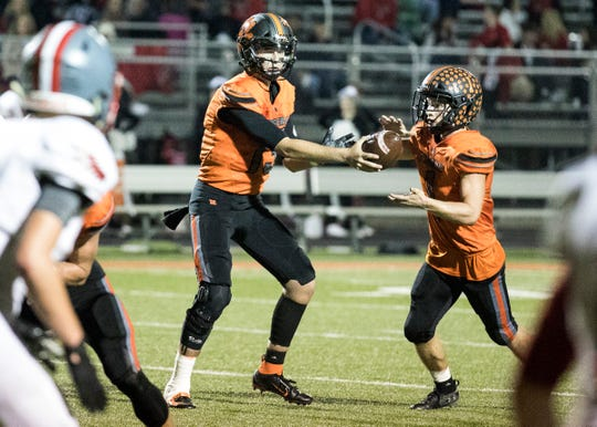 Waverly quarterback Haydn' Shanks hands the ball off to running back Payton Shoemaker during a 38-22 win over Minford on Oct. 25, 2019.