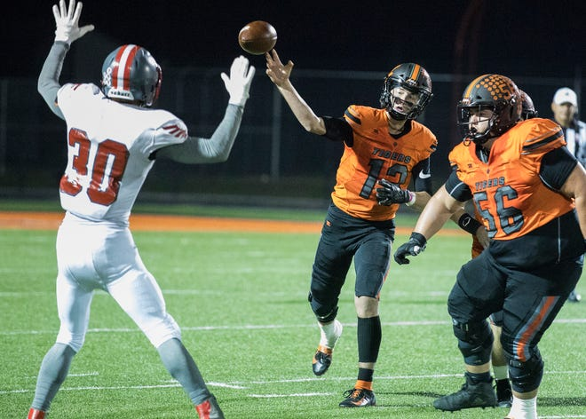 Waverly quarterback Haydn' Shanks throws a pass during a 38-22 win over Minford on Friday Oct. 25, 2019 in Waverly, Ohio.