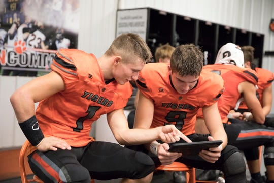 Waverly running back Payton Shoemaker sits with wide receiver Penn Morrison in the locker room during a 38-22 win over Minford on Friday, Oct. 25, 2019 in Waverly, Ohio.