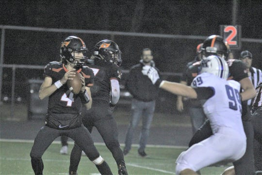 Ryle senior Keegan Stanken sets up to pass as Simon Kenton defeated Ryle 44-14 in Class 6A football October 25, 2019 at Ryle High School, Union KY.