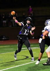 CHCA quarterback Cole Fisher fires a bullet pass for a first down, Oct. 25, 2019.