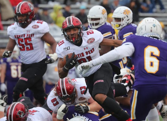 Austin Peay's Ahmaad Tanner (21) finds room to run in the middle of Tennessee Tech's defense during their OVC game Saturday Oct. 26, 2019 in Cookeville.