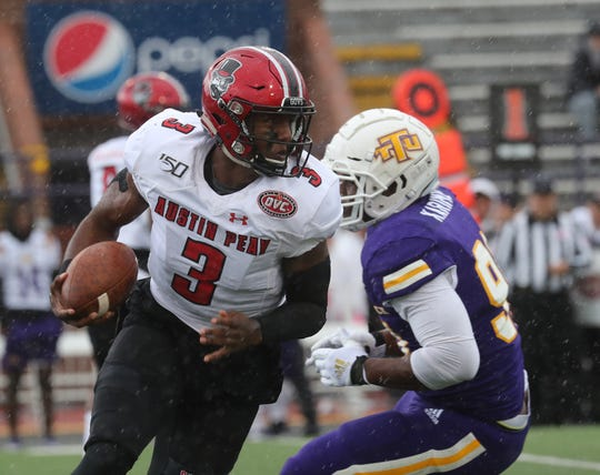 Austin Peay quarterback JaVaughn Craig (3) takes off down field against Tennessee Tech during their OVC football game Saturday Oct. 26, 2019 in Cookeville.